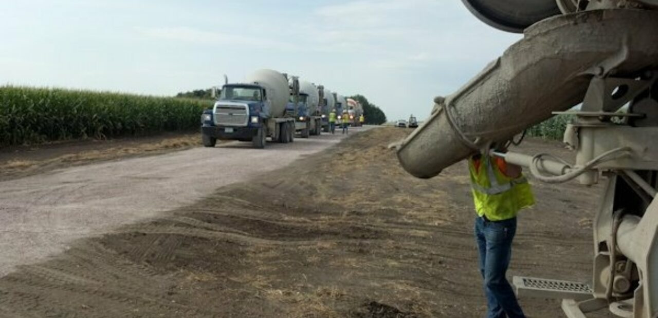 concrete truck pouring new road